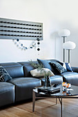 Wall decor with bars above the black leather sofa