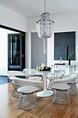 Dining room with designer furniture under the chandelier