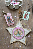 Christmas decoration handcrafted from book pages, scrapbook pictures of Father Christmas and angels and star made from sheet music