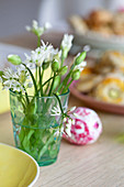 Ramsons flowers in glass of water on Easter table