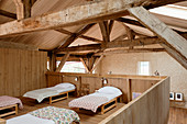 Sleeping area on gallery in converted, renovated barn