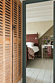 Louvered wooden storage cupboards provide generous space