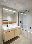 White wall tiles and concrete floor in bathroom