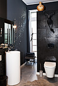 Glamorous black-and-white bathroom with pedestal sink