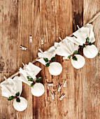 Garland of handmade Christmas pudding decorations wrapped in cloth