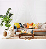 Couch with canopy, coffee table, side table and palm tree