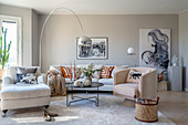 Various upholstered furnishings in elegant, beige living room