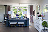Console table against back of sofa in classic, open-plan interior