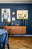 Retro sideboard in interior with blue wall