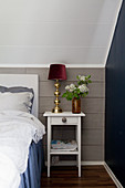 Knee wall clad in grey boards in bedroom