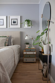 Scandinavian-style bedroom decorated in grey, white and green
