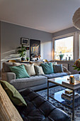 Many scatter cushions on sofa in pleasant living room