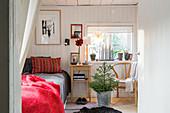 Small, cosy, sunny bedroom in Scandinavian style