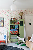 Old green cupboard in vintage-style child's bedroom