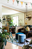 Many plants in vintage-style open-plan interior in shades of brown