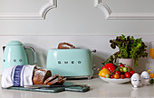 Retro toaster, sliced bread and breakfast ingredients
