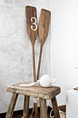 Stool and paddles in corner