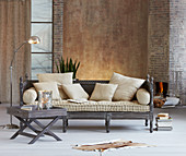 Oriental couch with beige cushions and tray table