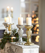 Christmas arrangement of sparkling silver and gold candlesticks