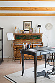 Desk and old piano in classic study