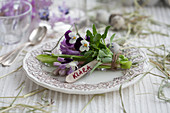 Posy of hyacinths and violas with name tag decorating plate