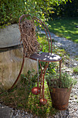 Old chair painted rust-red decorating garden