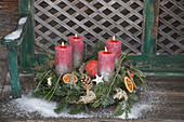 Classic Advent wreath of conifer branches, pine cones and orange slices