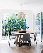 Round table with chairs in front of an open patio door
