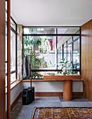 Modern entrance area with glazed windscreen