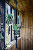 Macrame hanging planters in summer house