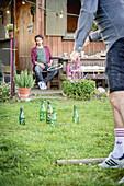 Men playing quoits in garden