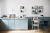 Dining table against two-tone wall in modern kitchen-dining room