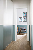 Fitted cupboards in hallway with two-tone walls