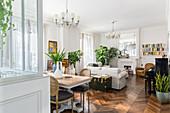 Classic open-plan interior with herringbone parquet floor in period building