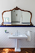 Ornate, antique mirror above vintage-style sink