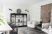 Black shelves in dining room decorated in mixture of Oriental and Scandinavian styles
