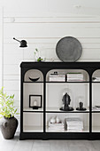Oriental ornaments on black shelves with white interior