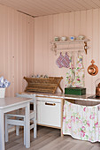 Children's kitchen in play house with pink walls