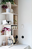 Irregular wooden shelves with compartments of various shapes in kitchen