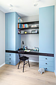 Pale blue fitted cupboards with integrated desk and shelves
