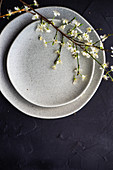 Spring table setting with peach blossom branch