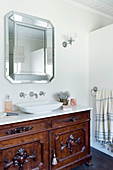 Antique vanity and wall mirror in the bathroom
