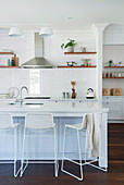 Filigree bar stools on the kitchen island in the open kitchen