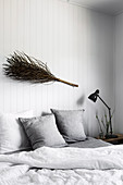 Dried fruit stand of a palm tree as decoration over the bed