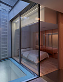 Minimalist bedroom with glass wall