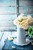Spring flowers, narcissus, in vase on wooden table