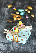 Gift box decorated with handmade Easter nests