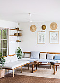 Simple living room in natural tones with wooden furniture