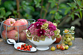 Arrangement of hydrangeas, sedum, chrysanthemums, apples and crab apples