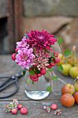 Bouquet of chrysanthemums, sedum and bog myrtle berries